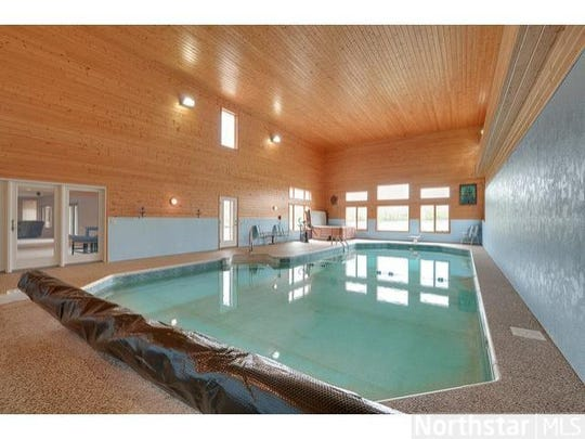 Perhaps the most impressive room in the house is the enormous indoor swimming pool.