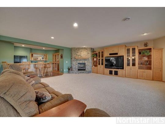 One half of the family room is a relaxed sitting area with an adjoining wet bar and kitchenette.