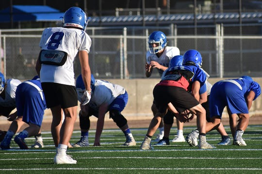 Dixie High has a stalwart offense with Reggie Graff (5) at quarterback, but the defense, led by Tyler Walden (8) will have its hands full with a scheme change.