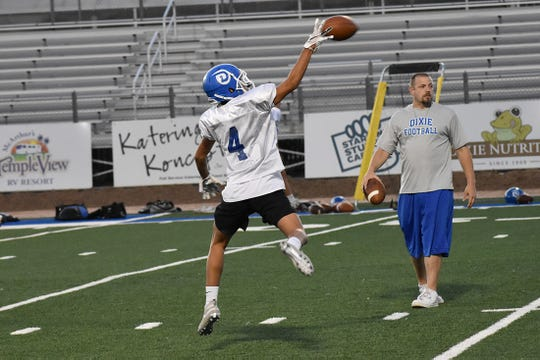 Dixie goes through practice drills on Monday, August 5.