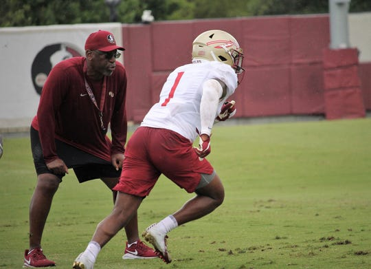 Defensive coordinator Harlon Barnett and defensive back Levonta Taylor at FSU football practice on Aug. 5, 2019.