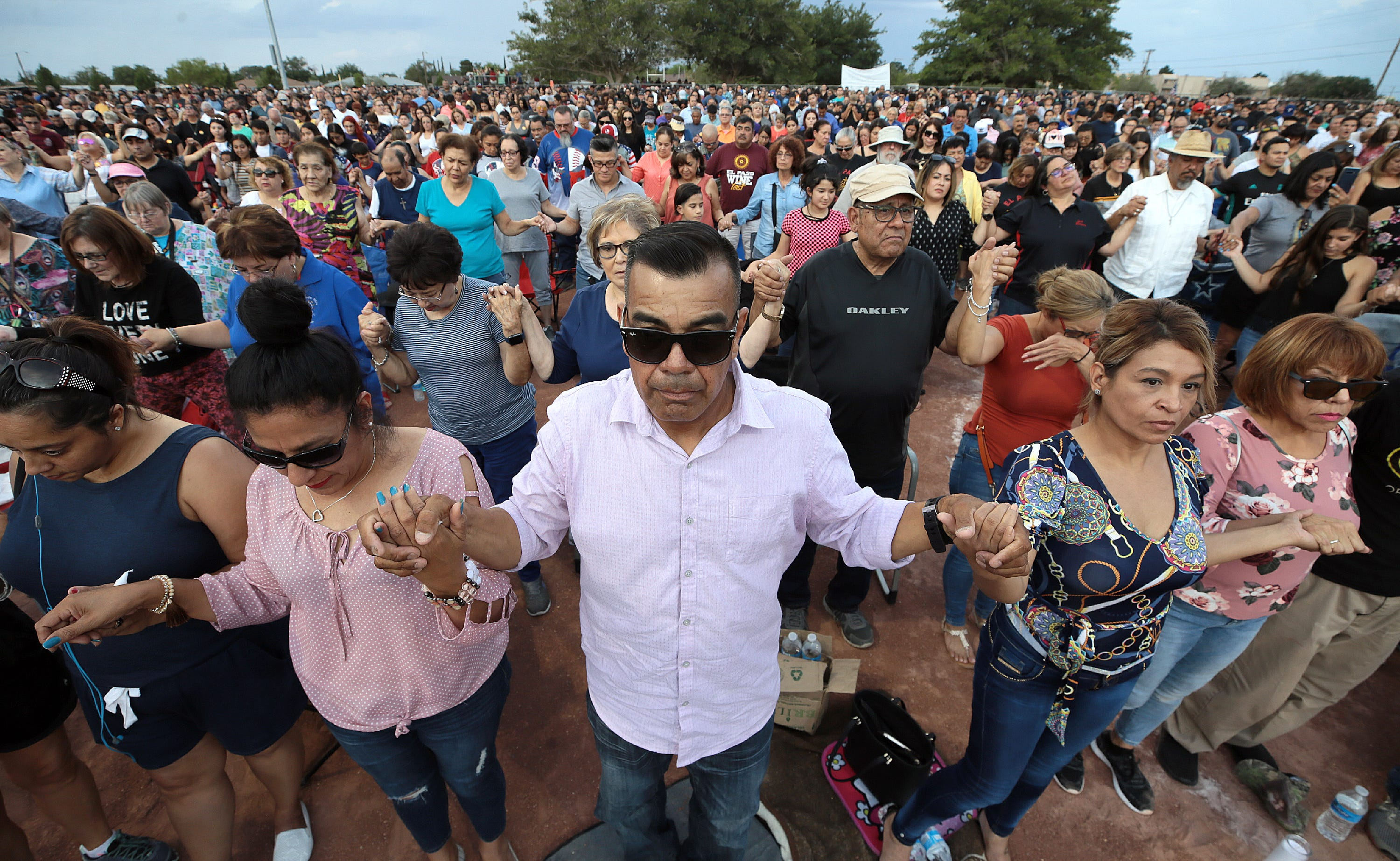 El Pasoans join hands and pray during the Hope Border Institute Prayer Vigil on Sunday, Aug. 4, 2019, in El Paso, Texas, a day after a mass shooting at a Walmart store killed 22 people and wounded 25 more.