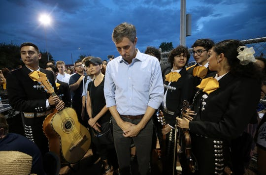 Presidential candidate and El Pasoan Beto O'Rourke prays during the Hope Border Institute Prayer Vigil August, 4, 2019 in El Paso, Texas a day after a mass shooting at a Walmart store killed 22 people and wounded 24 more.