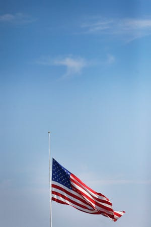 The flag is flown at half-staff outside of Camping World of El Paso on Monday, Aug. 5, 2019, after the Walmart shootings Saturday, Aug. 3, 2019, in El Paso, Texas.