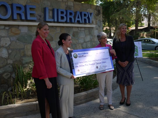 The Fillmore Library is receiving $1.5 million in state funding to expand and renovate its aging library. Presenting a ceremonial check Monday in Fillmore are Nancy Schram, Ventura County Library director; Monique Limon, state Assembly member; Hannah-Beth Jackson, state senator; and Kelly Long, county supervisor.