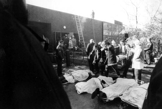 Firefighters line up recovered bodies outside the Stouffer's Hotel in Purchase,  on Dec. 4, 1980. Twenty-six people died  when a flash fire tore through a third-floor annex. JOURNAL NEWS FILE PHOTO