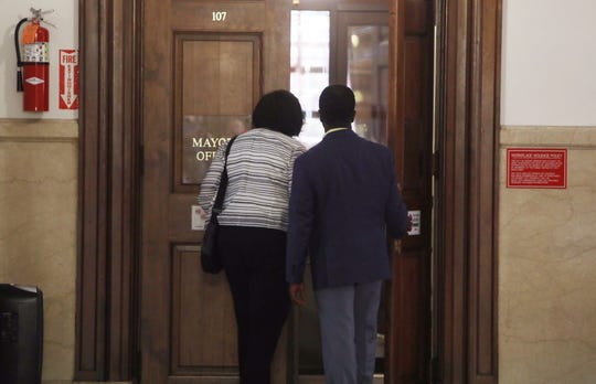 Lisa Copeland and Andre Wallace arrive at Mount Vernon City Hall for talks in the mayor's office on Monday, Aug. 5, 2019.