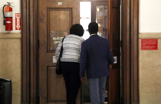 Lisa Copeland and Andre Wallace arrive at Mount Vernon City Hall for talks in the mayorÕs office Aug. 5, 2019.
