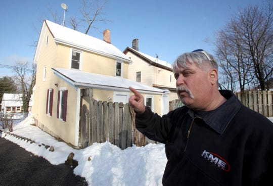 Firefighter Kenneth Patterson returns to a house in Haverstraw where he fought a stubborn fire in Jan. 2011. He got lost inside the burning home and passed out from smoke inhalation. The house had been illegally subdivided into apartments.