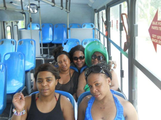 Nicole Warren-Curtis (back center) with her friends, including Shell Lewis (front left) in Cancun, Mexico in 2012.
