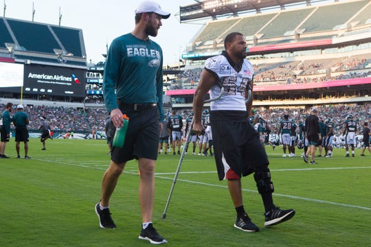 Injured linebacker Kamu Grugier-Hill walks on crutches back to the locker room during open practice Sunday, Aug. 4, at Lincoln Financial Field.