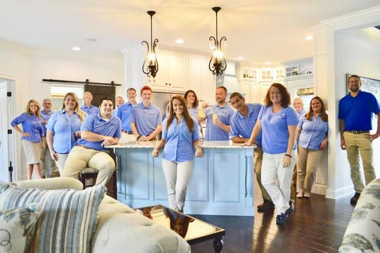Kaity West, pictured front and center, was working at Bay to Beach Builders in Greenwood when a Tesla ran into the building on July 21. She died early Sunday as a result of her injuries, the company said on Facebook.