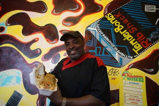 "Clint ""Chef Bones"" Harris weighs his 3-pound ""Chef Philly Cheesesteak"" sandwich that he created after his beloved Eagles won the Super Bowl. He has sold over 17,000 at his restaurant, TenderBones Rib Shack, in Bear. It's a special request item."