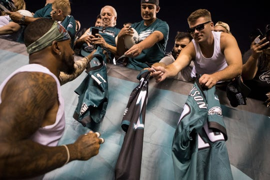 Eagles' DeSean Jackson signs autographs after a public practice session Sunday, Aug. 4 at Lincoln Financial Field.