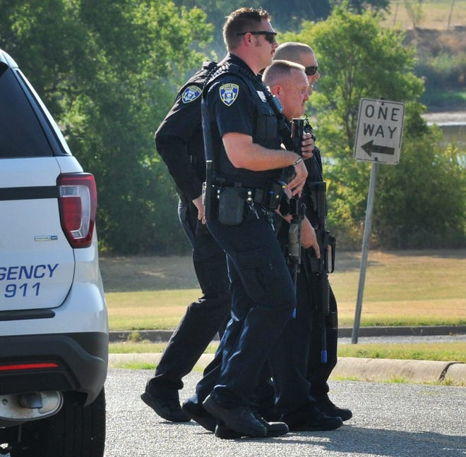 Wichita Falls police officers approach Kirby Middle School during an active shooter training exercise in this July 25, 2018, file photo.