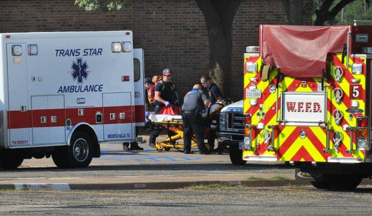 Emergency medical team members train during an exercise Tuesday morning involving an active shooter inside of a local school in this July 25, 2018, file photo
