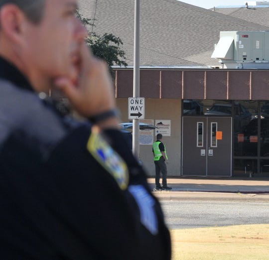 Wichita Falls police officers approach Kirby Middle School during an active shooter training exercise in this July 25, 2018, training.