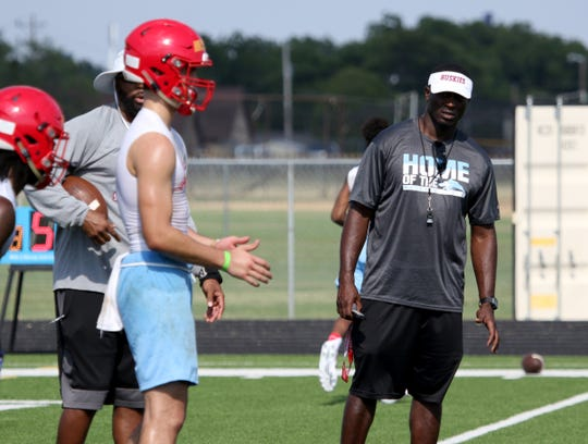 Hirschi head coach Antonio Wiley watches as senior quarterback Tryston Randall puts the Huskies through drills during the first day of practice Aug. 5.