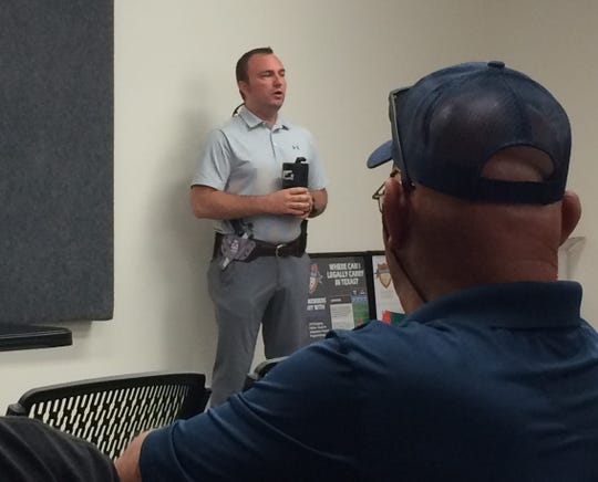 """Bryan Proctor of Cleburne discusses the """"avoid, deny and defend"""" strategy at the """"How to Survive an Active Shooter"""" seminar earlier at High Caliber Gun Range in this file photo published June 25, 2018. A retired police officer with more than 20 years in law enforcement, Proctor owns and is lead instructor for Arlington-based Go-Strapped Firearms Training."""