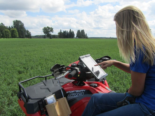 An AgSource Laboratory NMP/GPS Technician scouts a field.
