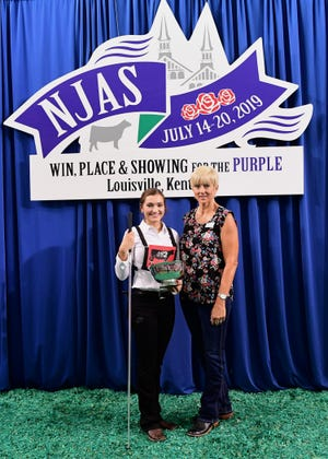Grace Link from Deerfield, Wis., was named champion showman at the National Junior Angus Show (NJAS).