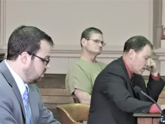 Tony Taylor, represented by attorney David Mortimer, listens to the statement of facts presented by Assistant Prosecutor Gerald Anderson during his sentencing this week.