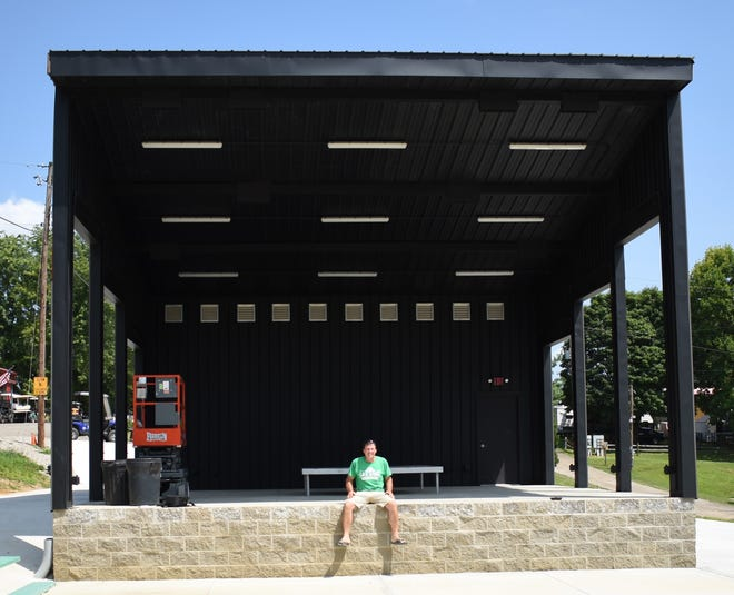 Gale Kirkbride, owner of LA-Z Acres Campground, sits on the property's new stage.