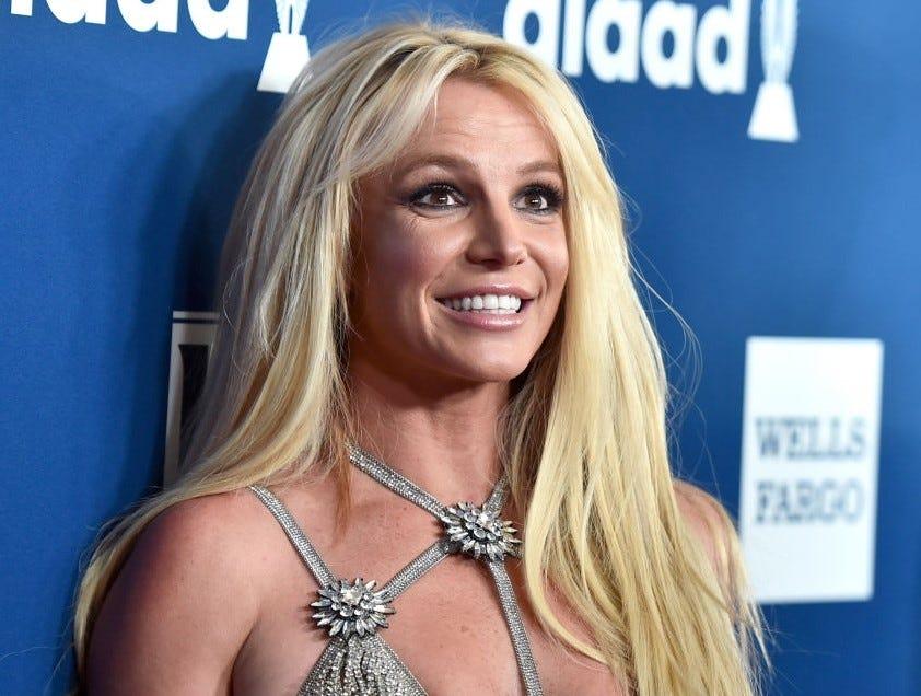 Britney Spears smiles.