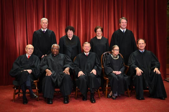 Supreme Court justices pose for the formal 2018 portrait of the Supreme Court of the United States. Seated from the left, Associate Justice Stephen Breyer, Associate Justice Clarence Thomas, Chief Justice of the United States John G. Roberts, Associate Justice Ruth Bader Ginsburg and Associate Justice Samuel Alito, Jr. Standing behind from left, Associate Justice Neil Gorsuch, Associate Justice Sonia Sotomayor, Associate Justice Elena Kagan and Associate Justice Brett M. Kavanaugh.