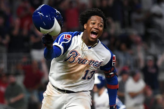 Ronald Acuna Jr. and the Braves lead the NL East.