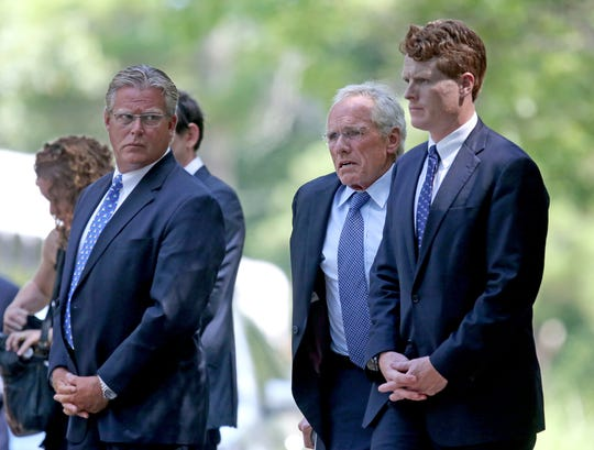 Edward M. Kennedy Jr., left, Joseph P. Kennedy II and his son U.S. Rep. Joseph Kennedy III, D-Mass., attend the funeral services for Saoirse Roisin Kennedy Hill at Our Lady of Victory Church in Centerville, Mass., on Aug. 5, 2019.
