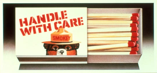 Smokey Bear's face was displayed commercially throughout the 1950s and '60s. Seen here on a box of matches, he was also featured on merchandise, in cartoons, on clothes and even a U.S. postage stamp.