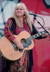 """In this Aug. 15, 1998, file photo, Melanie Safka, who performed at the original Woodstock decades ago, opens the second day of the festival """"Day In The Garden,"""" in Bethel, N.Y."""