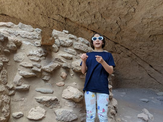 Erysse Elliott checks out the accommodations at Bandelier National Monument in 2019.