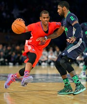 NBA guards Chris Paul and Kyrie Irving, shown here in the 2014 NBA All-Star game, both have invested in Beyond Meat plant-based products.