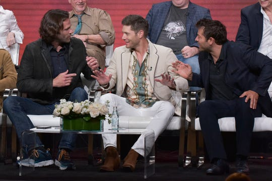 "Actors Jared Padalecki, left, Jensen Ackles and Misha Collins share a moment during a CW panel on the final season of their hit drama, ""Supernatural,"" at the Television Critics Association Sunday."