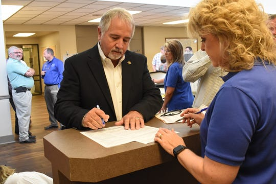 Mark Wood (left) with Robin Hooter, Rapides Clerk of Court, is among the six candidates who have qualified at the Rapides Parish Clerk of Court's Office. Qualifying runs through Thursday, and the list of candidates won't be official until qualifying is over.