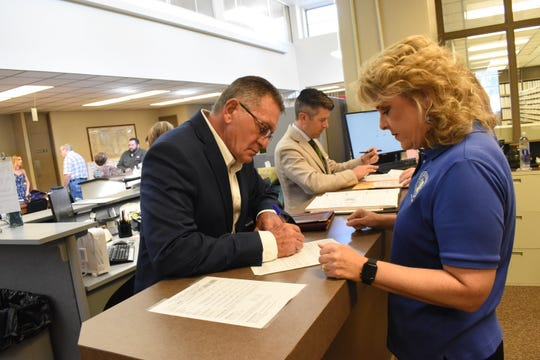 Ronnie Sellers (left) with Robyn Hooter, Rapides clerk of court, is among the six candidates who have qualified at the Rapides Parish Clerk of Court's Office. Qualifying runs through Thursday, and the list of candidates won't be official until qualifying is over.