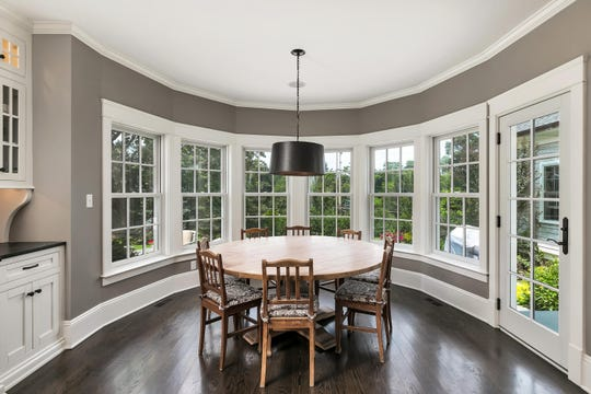The breakfast center offers custom windows and amazing crown molding.