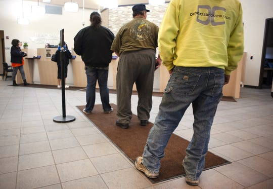 In this Nov. 16, 2018, file photo, credit union members stand in line at Blackhawk Community Credit Union on East Milwaukee Street in Janesville, Wis. Credit unions, with their great savings and loan rates and excellent service, offer an alternative to traditional banks.