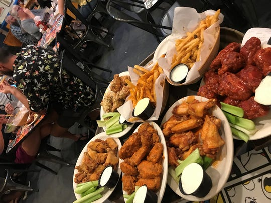 A selection of wings and fries from The Chicken or the Egg in Beach Haven.