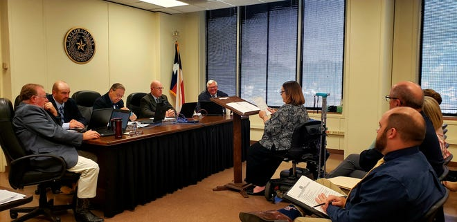 From left, Taylor County Commissioners Randy Williams and Kyle Kendrick, County Judge Downing Bolls, and Commissioners Brad Birchum and Chuck Statler listen to Cathy Taff, the county's director of human resources, Tuesday morning.