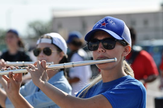 Sydney Forster plays the flute during Cooper High School marching band camp on school campus on Tuesday.