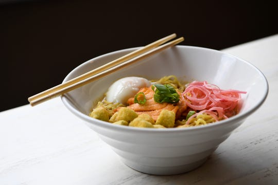 A Ton Kotsu noodle bowl at Broth Lab could be topped with a number of things including salmon, fried okra, pickled onions and a poached egg.