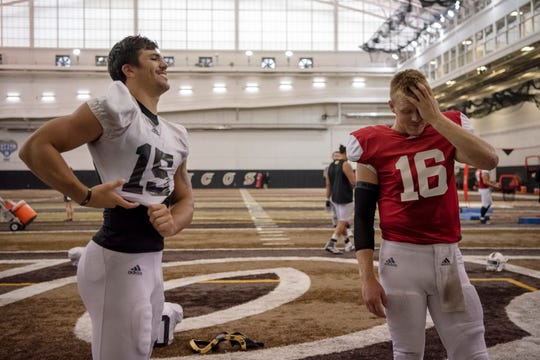 Western Michigan tight end Giovanni Ricci (15) and quarterback Jon Wassink (16) complete the first practice of the season with pads at Waldo Stadium on Tuesday, Aug. 6, 2019 in Kalamazoo, Mich.