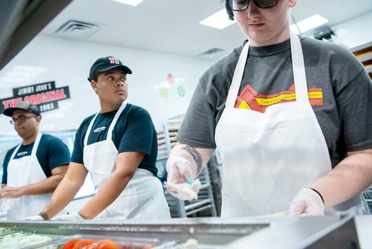 Bryaden Little and Shaun Evans prepare sandwiches at the new Jimmy John's restaurant on Tuesday, Aug. 6, 2019 in Battle Creek, Mich.