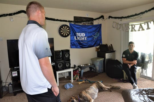Western Michigan quarterback Jon Wassink (left) talks to safety Justin Tranquil at the apartment they share in Kalamazoo, Mich, on Monday, July 29, 2019.