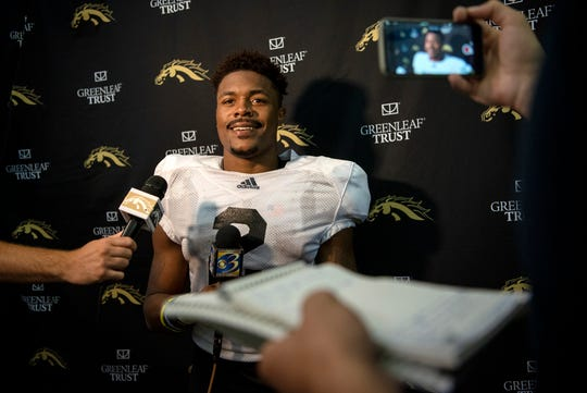 Western Michigan running back LeVante Bellamy (2) answers questions for media during the first practice of the season with pads at Waldo Stadium on Tuesday, Aug. 6, 2019 in Kalamazoo, Mich.