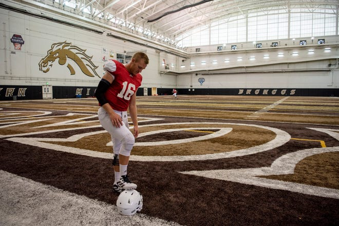 Western Michigan quarterback Jon Wassink (16) completes the first practice of the season with pads at Waldo Stadium on Tuesday, Aug. 6, 2019 in Kalamazoo, Mich.