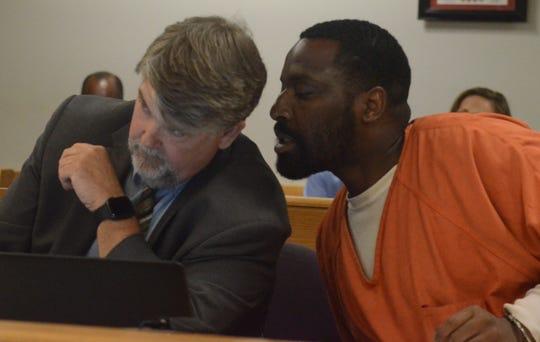 Randale Benjamin speaks with his attorney, Niels Magnusson